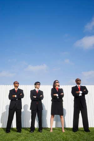 spectating: Multi-ethnic businesspeople wearing sunglasses