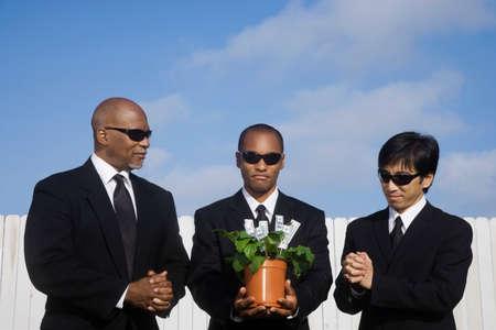 redeeming: Multi-ethnic businessman with money plant