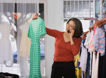 dubious: Hispanic woman shopping in clothing store