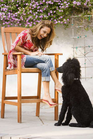 rubbing noses: Hispanic woman smiling at dog LANG_EVOIMAGES