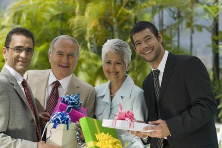 Hispanic businesspeople holding gifts Stok Fotoğraf
