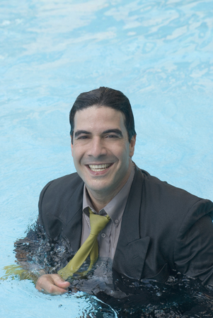 freeing: Hispanic businessman in swimming pool