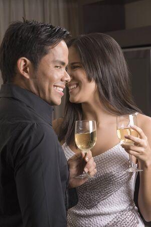 Hispanic couple drinking wine