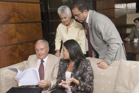 Hispanic businesspeople discussing paperwork