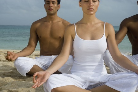 well beings: Multi-ethnic friends meditating on beach
