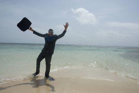 portable failure: Hispanic businessman wearing snorkeling gear