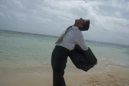 telecommuter: Hispanic businessman taking off jacket