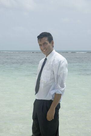 saturating: Hispanic businessman in water
