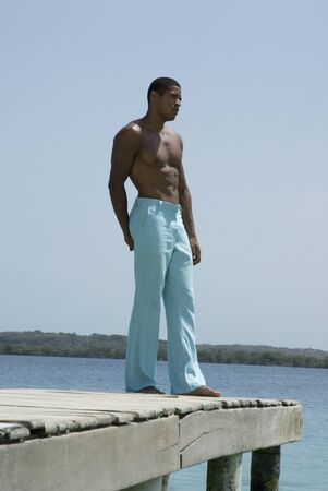 freeing: Hispanic man standing on dock