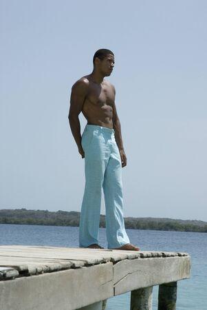 freeing: Hispanic man standing on dock