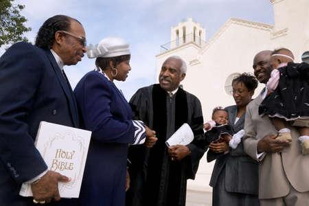 interrogating: African Reverend greeting parishioners