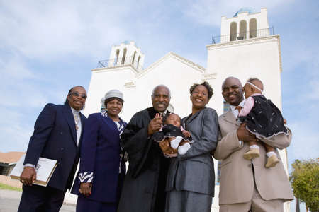 ministry: African family in front of church