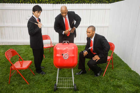 snooping: Multi-ethnic businessmen looking at barbeque