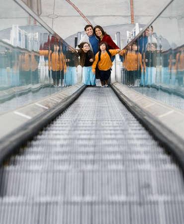 Hispanic family on escalator LANG_EVOIMAGES