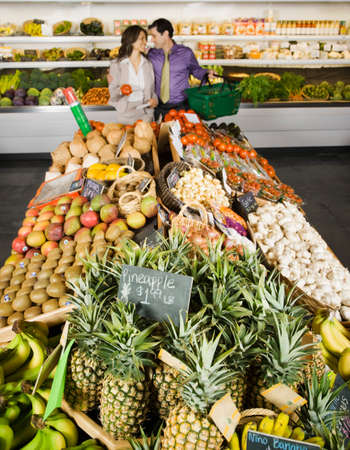 Hispanic couple shopping in grocery store Stock Photo