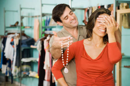 saturating: Hispanic man surprising wife with necklace