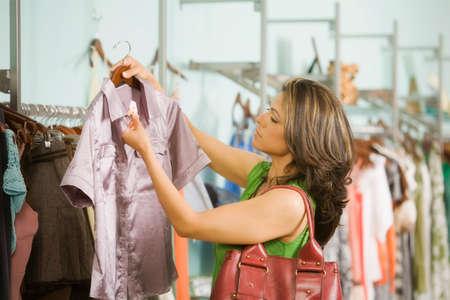 davenport: Hispanic woman shopping in clothing store