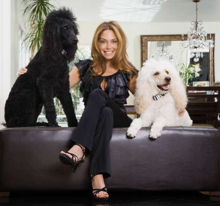 aggravated: Hispanic woman with dogs LANG_EVOIMAGES