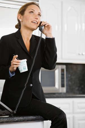 fruit eater: Hispanic businesswoman talking on telephone