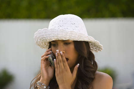 nonconformity: Hispanic woman talking on cell phone LANG_EVOIMAGES