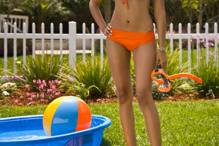 shrieking: Hispanic woman in bikini next to kiddie pool LANG_EVOIMAGES