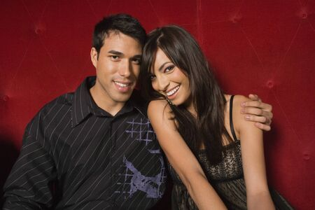 spanish ethnicity: Young multi-ethnic couple hugging LANG_EVOIMAGES