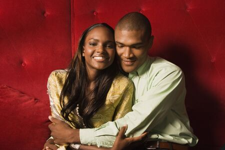 wearying: Young African couple hugging LANG_EVOIMAGES