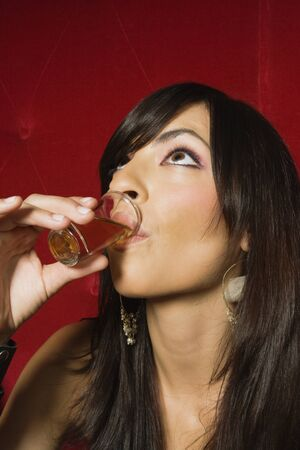 jesting: Middle Eastern woman drinking alcohol shot