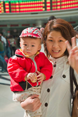 Asian mother holding baby