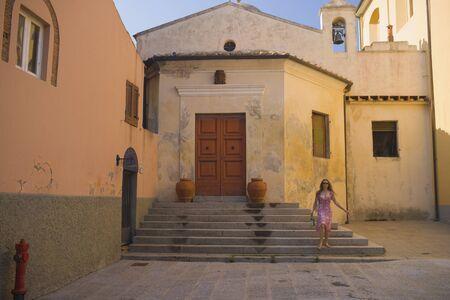 cherishing: Hispanic woman at historic church
