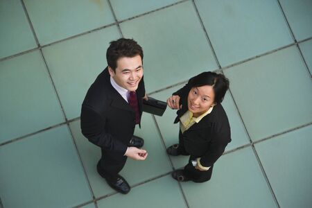 one mid adult man: High angle view of Asian businesspeople LANG_EVOIMAGES