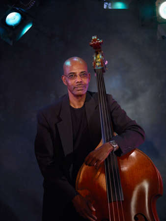 nite: African man holding upright bass LANG_EVOIMAGES