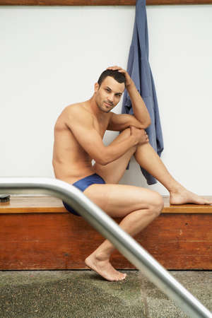 togs: Mixed Race man wearing bathing suit LANG_EVOIMAGES