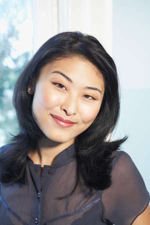 attired: Close up of Asian woman smiling