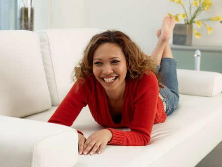 nite: Asian woman laying on sofa