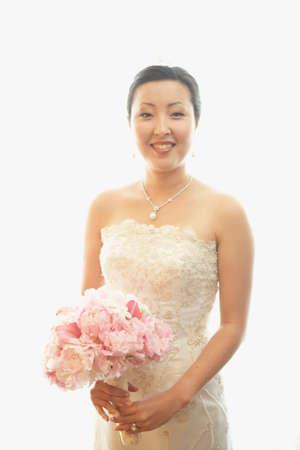 attired: Portrait of Asian bride LANG_EVOIMAGES