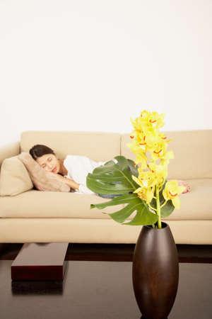 slumbering: Asian woman sleeping on sofa