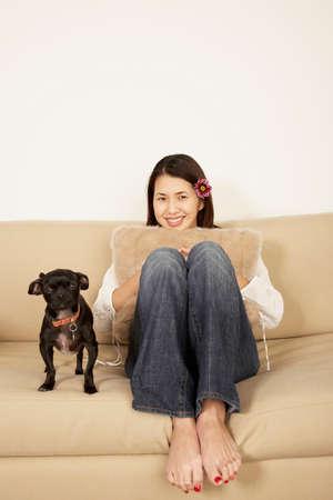 slumbering: Asian woman sitting on sofa LANG_EVOIMAGES