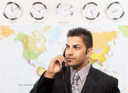 talker: Indian businessman talking on telephone