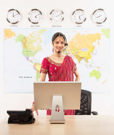 well beings: Indian businesswoman wearing headset