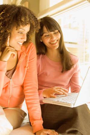 folding camera: Multi-ethnic women looking at laptop