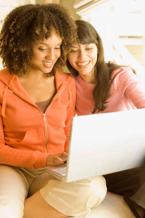 davenport: Multi-ethnic women looking at laptop