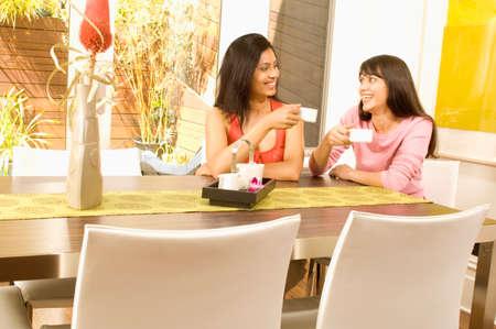 slumbering: Hispanic women drinking coffee LANG_EVOIMAGES