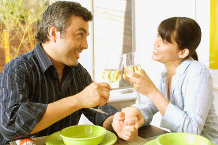 spewing: Hispanic couple toasting with wine