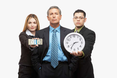 joining forces: Hispanic businesspeople with clock and money LANG_EVOIMAGES