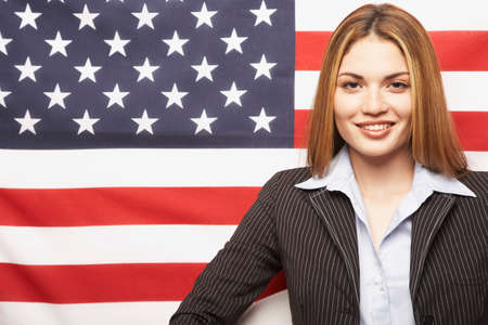 joining forces: Hispanic businesswoman in front of American flag