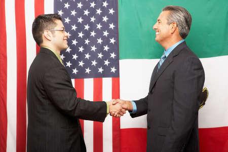 joining forces: Hispanic businessmen shaking hands