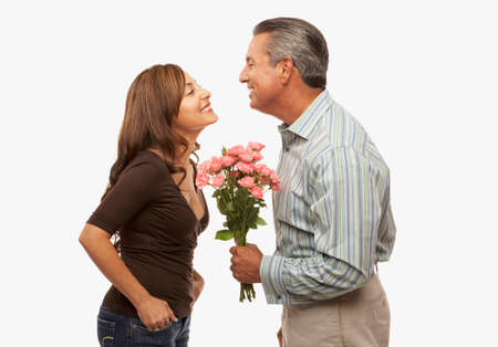 world at your fingertips: Hispanic man giving flowers to wife