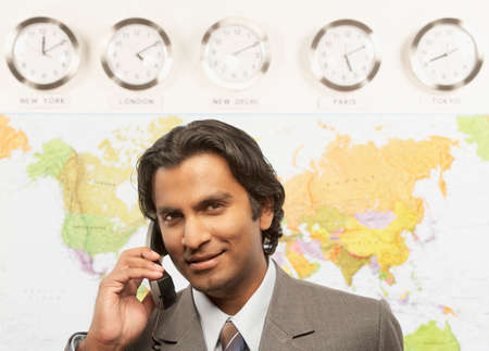 bestowing: Indian businessman talking on telephone