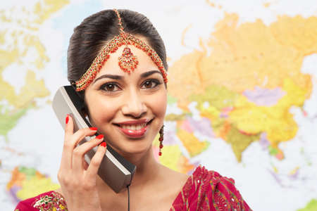 feasting: Indian businesswoman talking on telephone